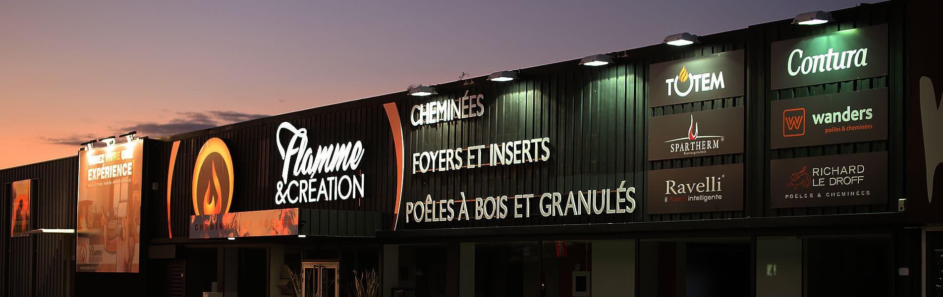 Enseigne lumineuse à Lyon - Caisson toile tendue retroéclairé et lettres boitiers - Flamme et Création sur la RN6 à St Priest